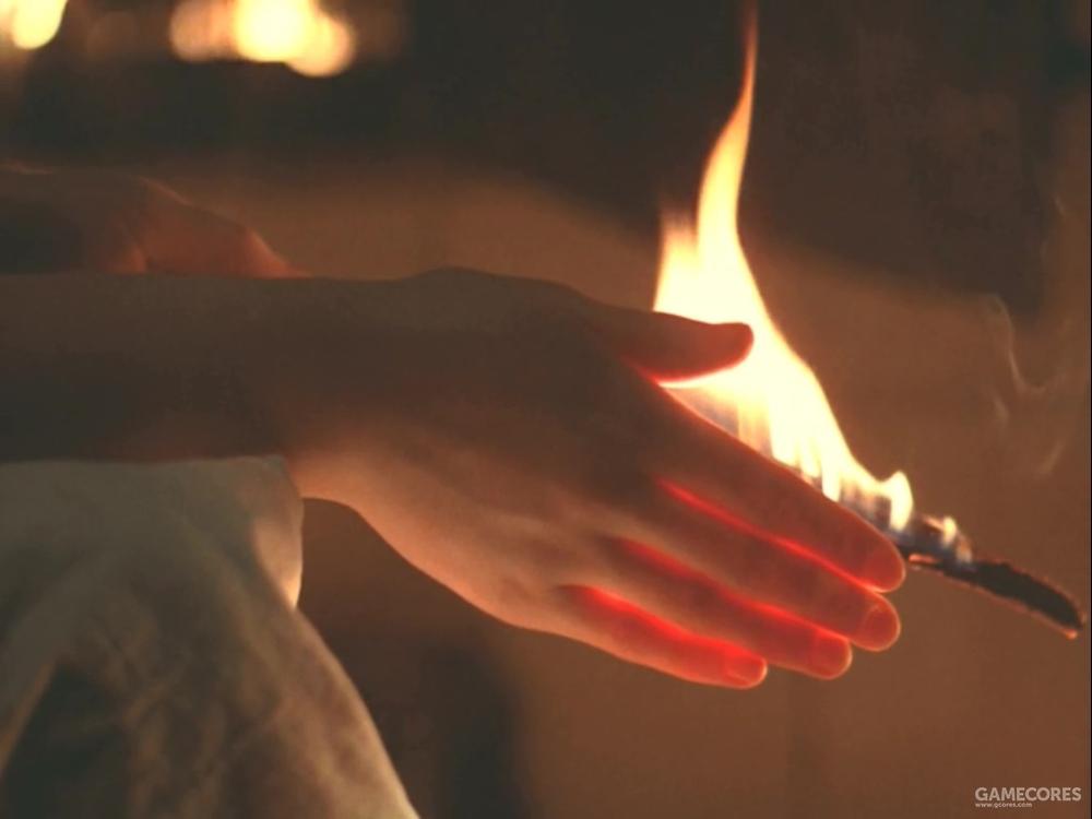 一只手感受火的温暖