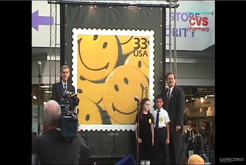 """在1999年首个""""世界微笑日""""上美国专利局展示了""""哈维鲍尔笑脸""""纪念邮票"""