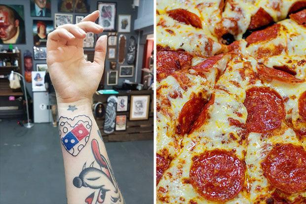 俄罗斯披萨店的纹餐厅logo即可终身免费吃活动,因太多人纹身被迫中止